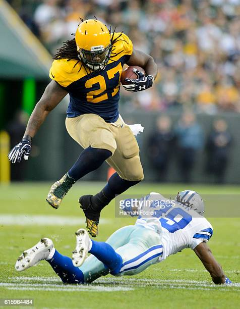 Eddie Lacy of the Green Bay Packers leaps over Brandon Carr of the Dallas Cowboys during the game on October 16, 2016 at Lambeau Field in Green Bay,...