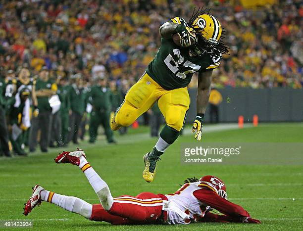 Eddie Lacy of the Green Bay Packers leaps over Ron Parker of the Kansas City Chiefs to run for a first down at Lambeau Field on September 28 2015 in...