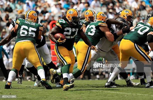 Eddie Lacy of the Green Bay Packers runs for yardage during the game against the Jacksonville Jaguars at EverBank Field on September 11 2016 in...