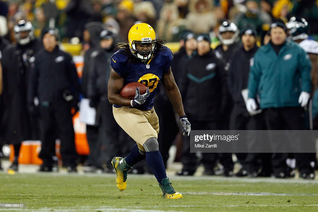 Eddie Lacy #27 of the Green Bay Packers runs the ball against the Philadelphia Eagles during the game at Lambeau Field on November 16, 2014 in Green Bay, Wisconsin.
