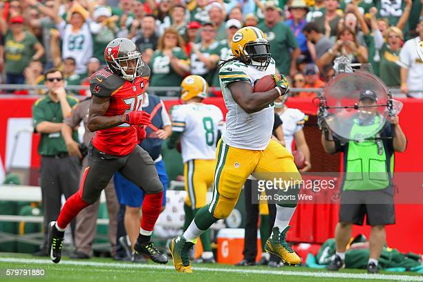 Eddie Lacy of the Packers runs along the sidelines to the end zone for a touch down during the regular season game between the Green Bay Packers and...