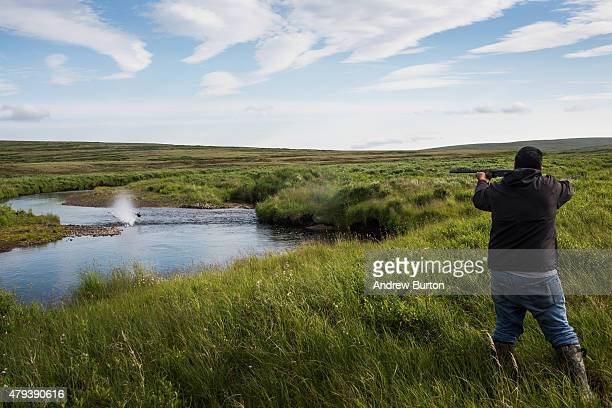 Eddie Lopez hunts for duck on Nelson Island on July 2 2015 near Newtok Alaska Newtok has a population of approximately of 375 ethnically Yupik people...