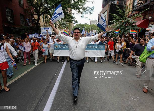Eddie Marrero leads marchers from the group New Yorkers United for Marriage during the 2011 NYC LGBT Pride March on the streets of Manhattan on June...