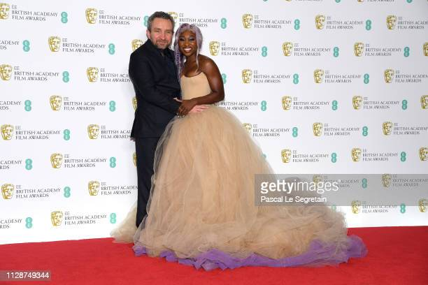 Eddie Marsan and Cynthia Erivo pose in the press room during the EE British Academy Film Awards at Royal Albert Hall on February 10 2019 in London...