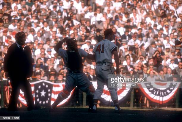 Eddie Mathews of the Milwaukee Braves bats as catcher Yogi Berra of the New York Yankees throws the ball back to the pitcher during Game 5 of the...