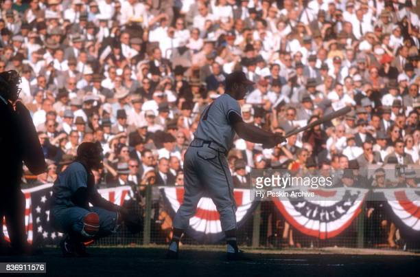 Eddie Mathews of the Milwaukee Braves bats as catcher Yogi Berra of the New York Yankees sets up behind the plate during Game 5 of the 1957 World...