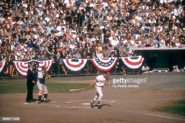 Eddie Mathews of the Milwaukee Braves draws the walk as catcher Yogi Berra of the New York Yankees looks on during Game 5 of the 1957 World Series on...