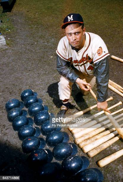 Eddie Mathews of the Milwaukee Braves poses for a portrait with helmets and baseball bats circa March 1958 in Florida