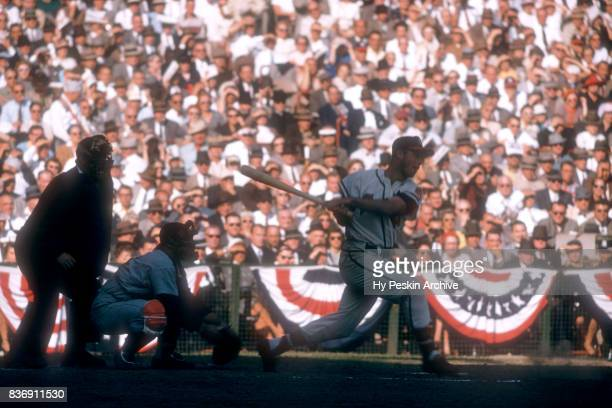 Eddie Mathews of the Milwaukee Braves swings at the pitch as catcher Yogi Berra of the New York Yankees sets up behind the plate during Game 5 of the...