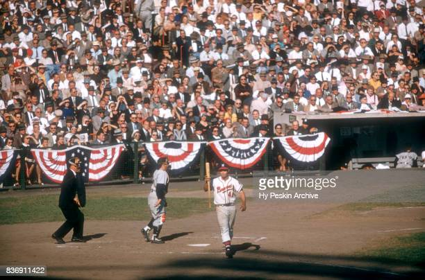 Eddie Mathews of the Milwaukee Braves walks around the batter's box as catcher Yogi Berra of the New York Yankees looks on during Game 5 of the 1957...