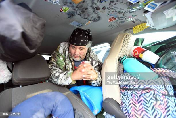 Eddie Mathis who has been living in his car looks on from an evacuee encampment at a Walmart parking lot in Chico California on November 19 2018