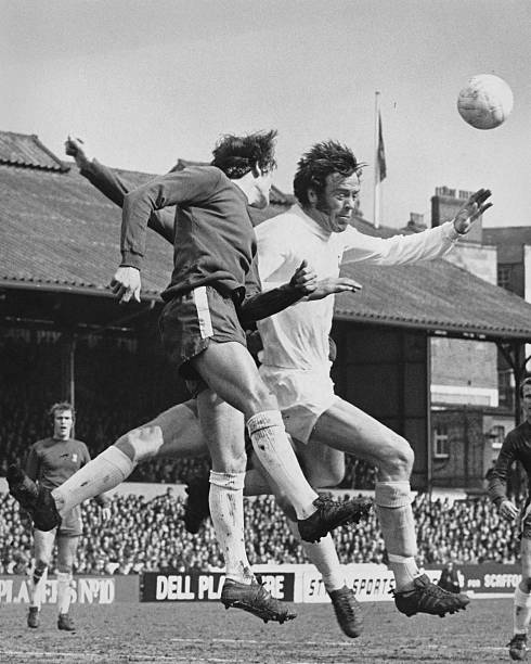 Eddie McCreadie captain of Chelsea jumps to challenge Tottenham Hotspur centre back Mike England during their English League Division One match on 4...