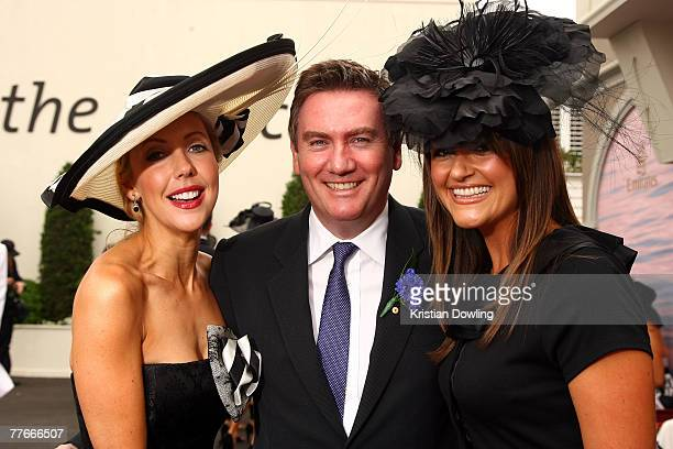 Eddie McGuire and wife Carla pose with Catriona Rowntree at the Emirates Marquee on the first day of the Melbourne Cup Carnival Derby Day at...