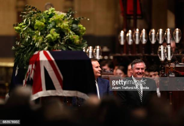 Eddie McGuire President of the Collingwood Magpies listens in to Ron Joseph during the former Collingwood legend Lou Richards state funeral at St...