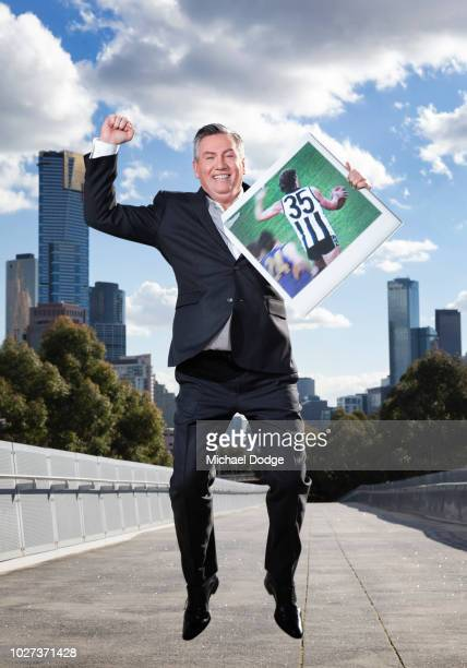 Eddie McGuire shows off his favorite moment with his polaroid off Magpies legend Peter Daicos kicking a mercurial goal during the FOX FOOTY AFL...