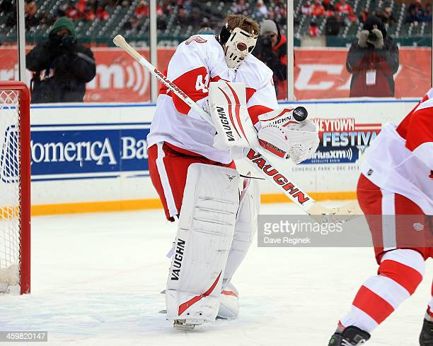 Eddie Mio of the Detroit Red Wings Alumni makes a save with his old style mask against the Toronto Maple Leafs Alumni during the 2014 Bridgestone NHL...