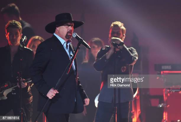 Eddie Montgomery and Dierks Bentley perform onstage at the 51st annual CMA Awards at the Bridgestone Arena on November 8 2017 in Nashville Tennessee