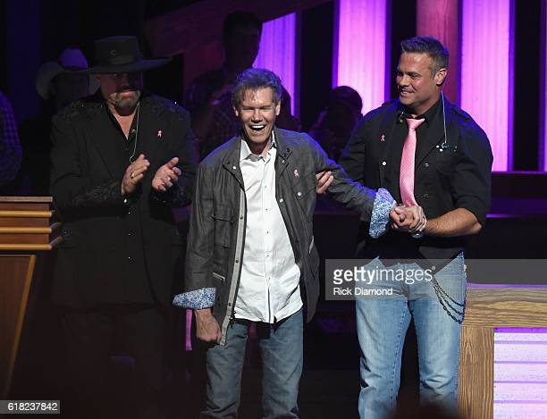 Eddie Montgomery and Troy Gentry escort Singer/Songwriter Randy Travis on stage at Jason Aldean's 11th Annual Event Benefitting Susan G Komen As Part...