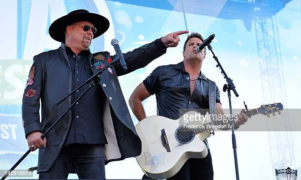 Eddie Montgomery and Troy Gentry of Montgomery Gentry perform during the 2012 CMA Music Festival on June 7 2012 in Nashville Tennessee