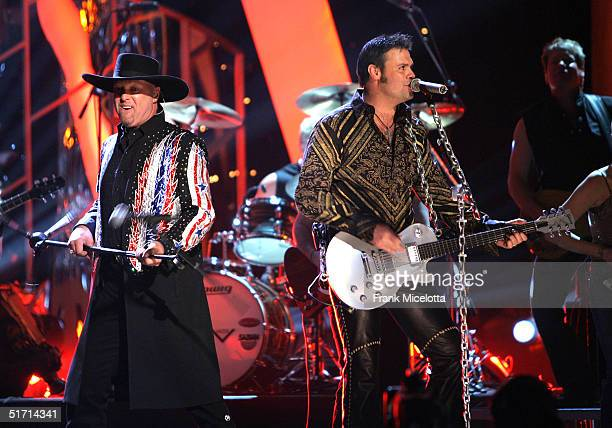 Eddie Montgomery and Troy Gentry of Montgomery Gentry perform on stage at the 38th Annual CMA Awards at the Grand Ole Opry House November 9 2004 in...