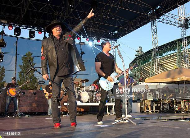Eddie Montgomery and Troy Gentry of Montgomery Gentry performs during the 2012 Downtown Hoedown at Comerica Park on June 9 2012 in Detroit Michigan