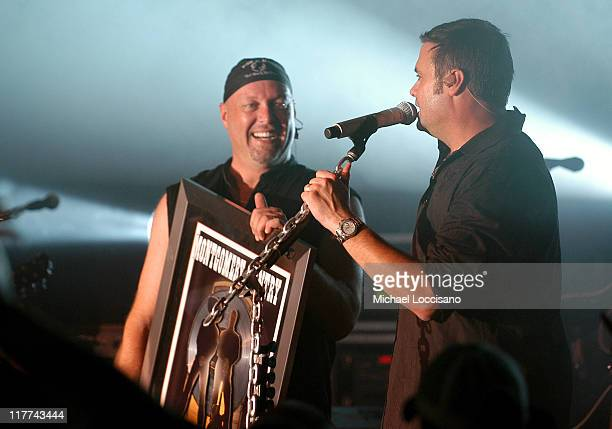 Eddie Montgomery and Troy Gentry of Montgomery Gentry with Platinum Record