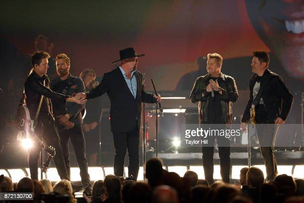 Eddie Montgomery performs with Dierks Bentley and Rascall Flatts at the 51st annual CMA Awards at the Bridgestone Arena on November 8 2017 in...