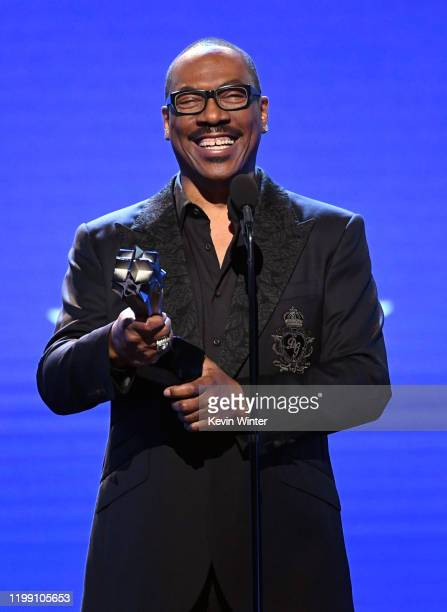 Eddie Murphy accepts the Lifetime Achievement Award onstage during the 25th Annual Critics' Choice Awards at Barker Hangar on January 12 2020 in...