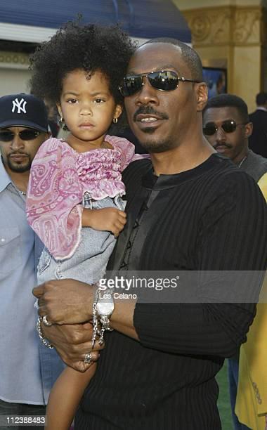 Eddie Murphy and daughter during Shrek 2 Los Angeles Premiere Red Carpet at Mann Village Westwood in Westwood California United States
