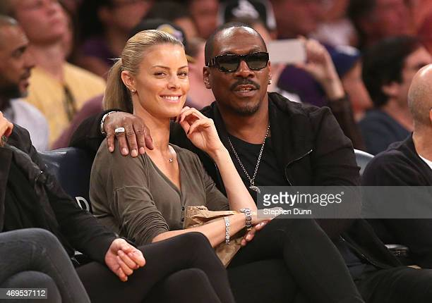 Eddie Murphy and girlfriend Paige Butcher attend the game between the Dallas Mavericks and the Los Angeles Lakers at Staples Center on April 12 2015...