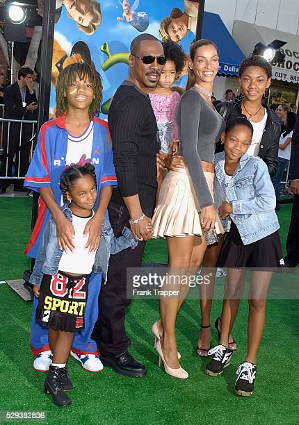 """Eddie Murphy and his wife Nicole arrive with their family to the Los Angeles premiere of the animated fantasy motion picture """"Shrek 2"""" held at Mann..."""