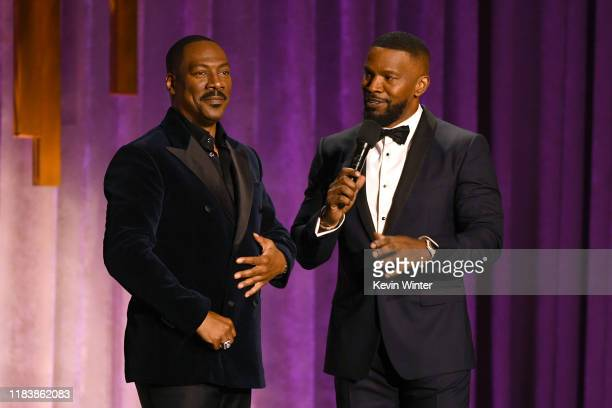 Eddie Murphy and Jamie Foxx speak onstage during the Academy Of Motion Picture Arts And Sciences' 11th Annual Governors Awards at The Ray Dolby...