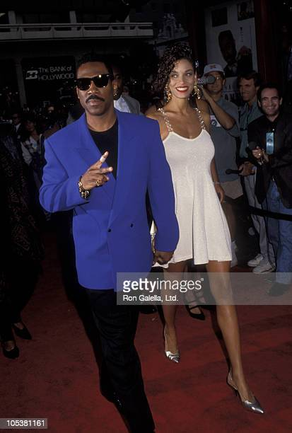 Eddie Murphy and Nicole Mitchell during Boomerang Los Angeles Premiere Arrivals at Mann's Chinese Theater in Hollywood California United States