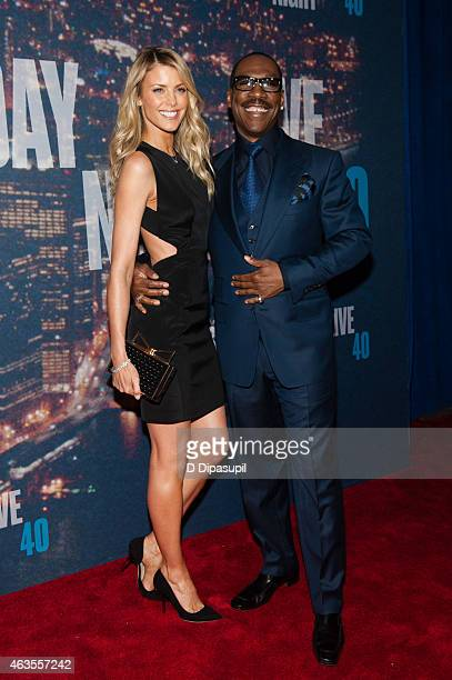 Eddie Murphy and Paige Butcher attend the SNL 40th Anniversary Celebration at Rockefeller Plaza on February 15 2015 in New York City
