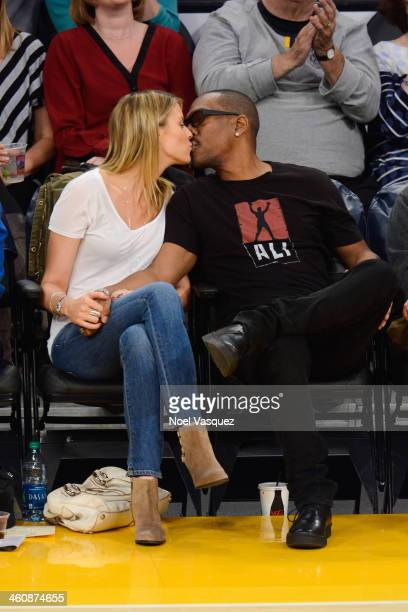 Eddie Murphy and Paige Butcher kiss at a basketball game between the Denver Nuggets and the Los Angeles Lakers at Staples Center on January 5 2014 in...