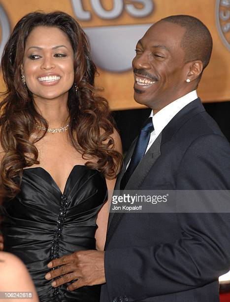Eddie Murphy and Tracey Edmonds during 13th Annual Screen Actors Guild Awards Arrivals at Shrine Auditorium in Los Angeles California United States