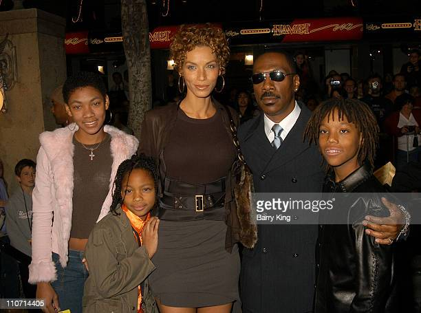 """Eddie Murphy and wife Nicole and children during """"The Haunted Mansion"""" World Premiere at El Capitan Theatre in Hollywood, California, United States."""