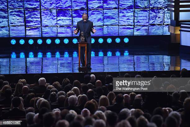 Eddie Murphy does a Bill Cosby impression during his speech as he accepts the Mark Twain Prize for American Humor at the Kennedy Center that honored...