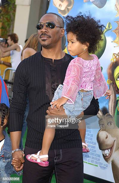 Eddie Murphy holding his daughter Bella attends the Los Angeles premiere of the animated fantasy motion picture Shrek 2 held at Mann Village Theatre