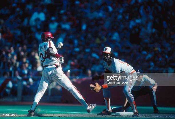 Eddie Murray of the Baltimore Orioles covers first base and waits for the throw against Gary Matthews of the Philadelphia Phillies as he gets back to...
