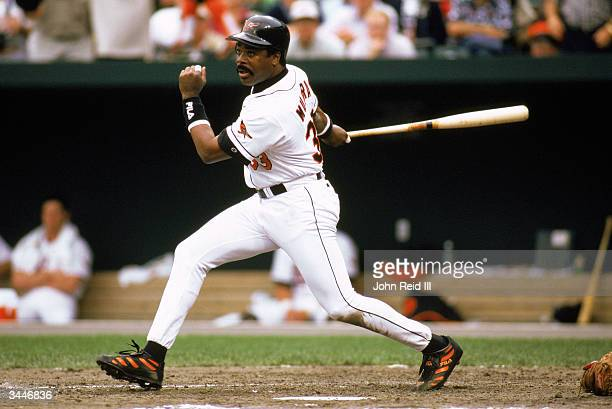 Eddie Murray of the Baltimore Orioles swings at a pitch during a 1996 season game at Camden Yards in Baltimore, Maryland.