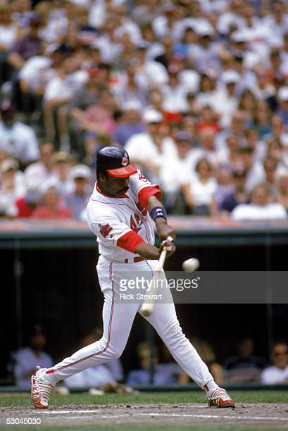 Eddie Murray of the Cleveland Indians looks to connect with the pitch during a game against the Texas Rangers at Jacobs Field on May 18 1996 in...