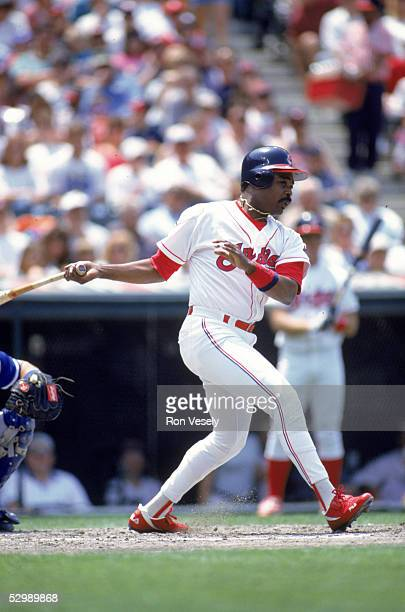 Eddie Murray of the Cleveland Indians stands swins a the pitch during a season game against the Toronto Blue Jays at Jacobs Field on June 4 1995 in...