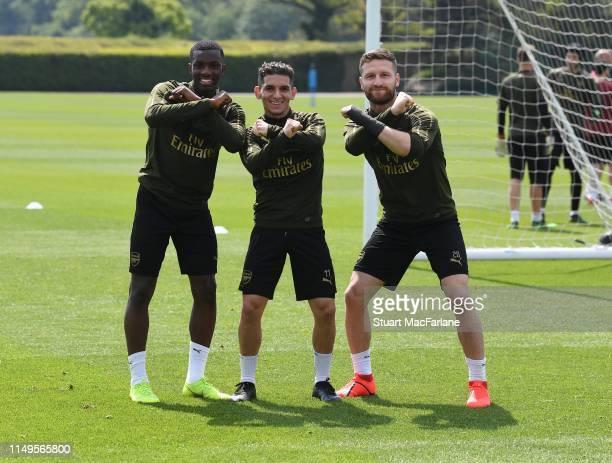 Eddie Nketaih Lucas Torreira and Shkodran Mustafi of Arsenal during a training session at London Colney on May 16 2019 in St Albans England