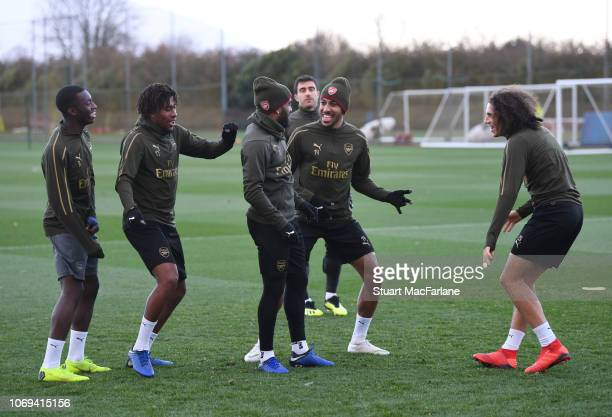 Eddie Nketiah Alex Iwobi Alex Lacazette PierreEmerick Aubameyang and Matteo Guendouzi of Arsenal during a training session at London Colney on...