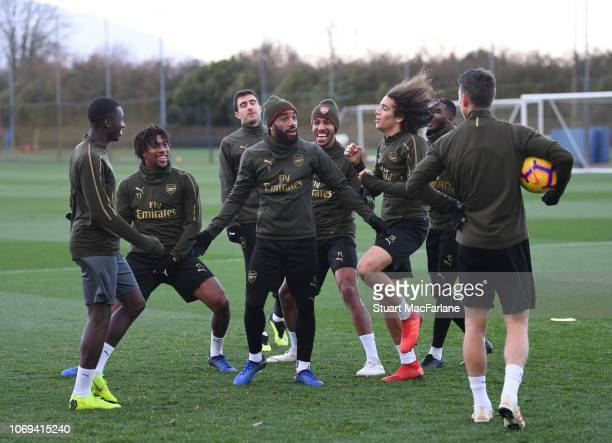 Eddie Nketiah Alex Iwobi Alex Lacazette PierreEmerick Aubameyang Matteo Guendouzi and Laurent Koscielny of Arsenal during a training session at...