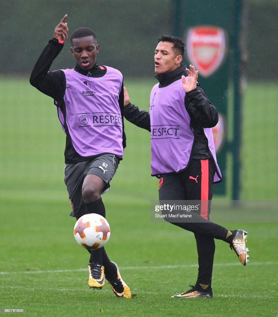 Eddie Nketiah and Alexis Sanchez of Arsenal during a training session at London Colney on October 18, 2017 in St Albans, England.