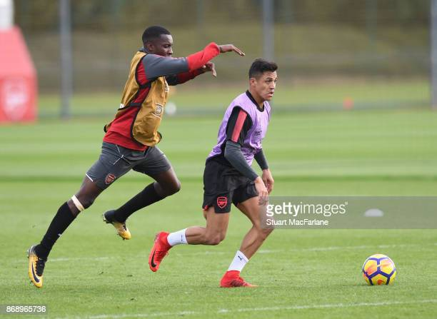Eddie Nketiah and Alexis Sanchez of Arsenal during a training session at London Colney on November 1 2017 in St Albans England