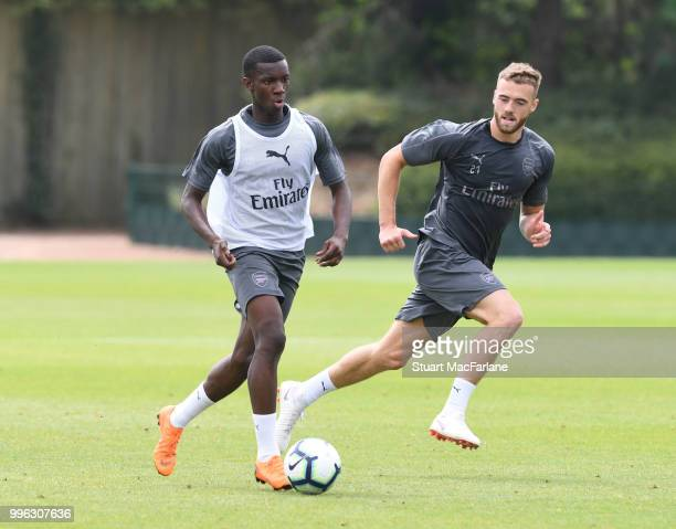 Eddie Nketiah and Calum Chambers of Arsenal during a training session at London Colney on July 11 2018 in St Albans England