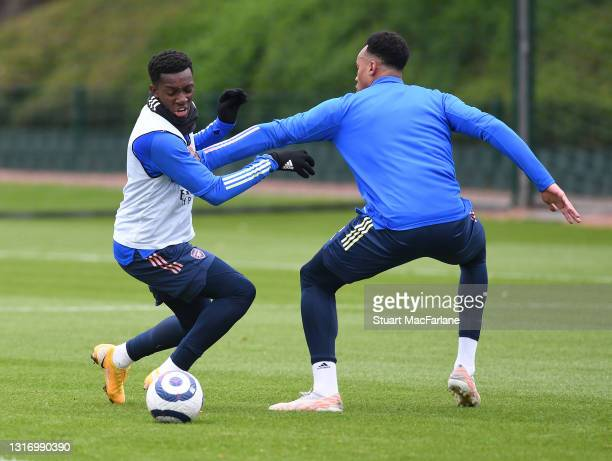 Eddie Nketiah and Gabriel of Arsenal during a training session at London Colney on May 08, 2021 in St Albans, England.